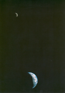 The first picture of the Moon and Earth together in space, taken by Voyager 1.
